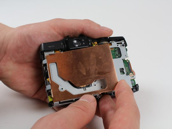 Be careful not to bend the EMI shield.