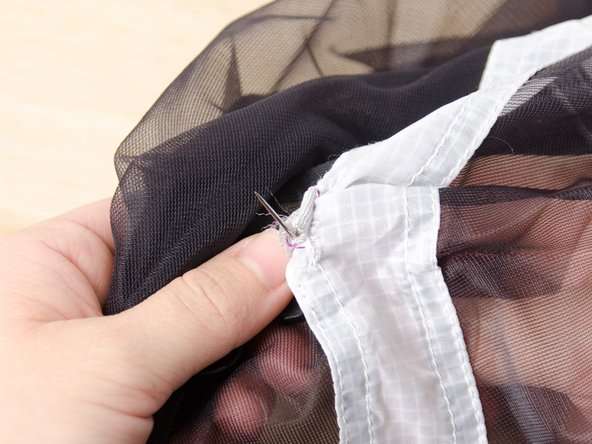 Continue sewing through both layers, going down from the top and up from the bottom, as described in steps 3 and 4 of this guide.