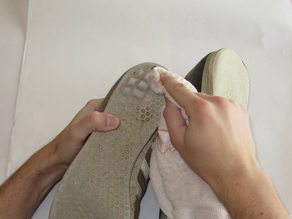 To begin, clean the Adidas Gazelles with some  water on a  towel.