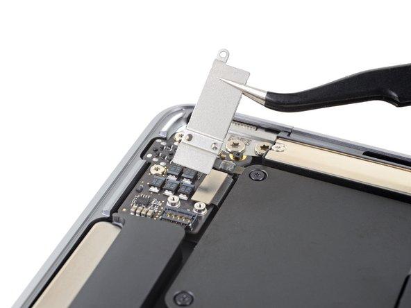 Remove the audio board connector cover.