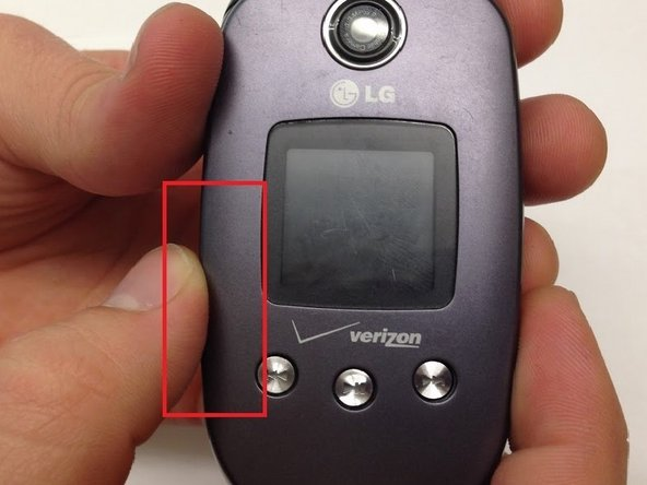 Close the phone and gently pull outwards from the bottom left portion of the phone cover.