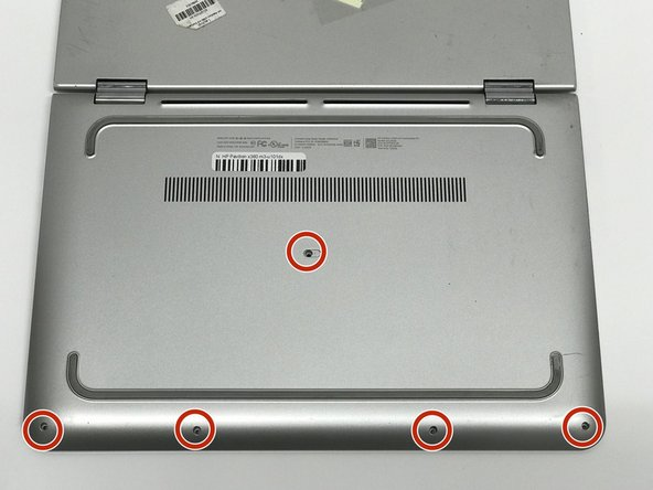 Remove five 1.4mm Phillips #1 screws from the bottom of the laptop.