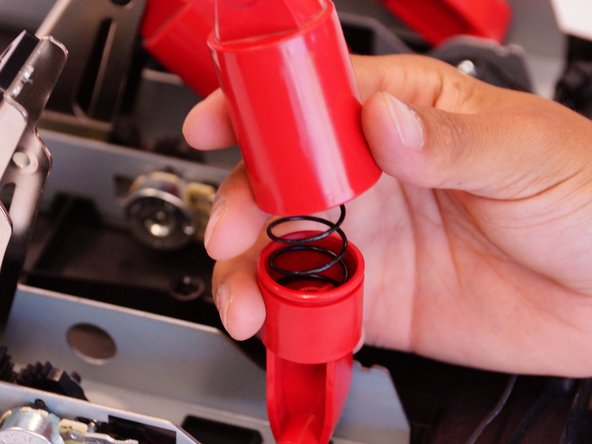 Flip the piston away from the pedal and remove the top half of it. The spring should now be visible. (NEED PICTURE)