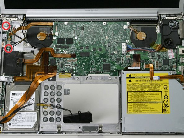 Remove the two identical T8 Torx screws from the DC-In board.