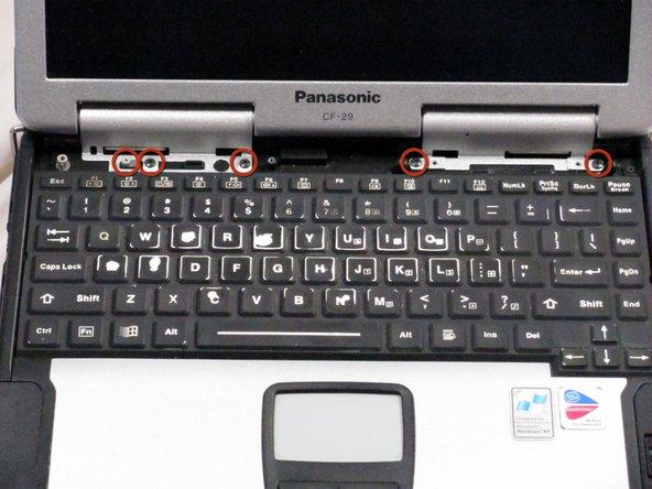 Remove the five silver screws shown.