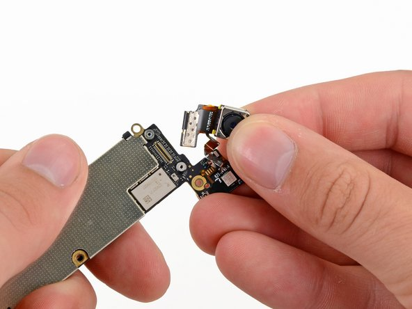 Remove the rear-facing camera from the logic board.