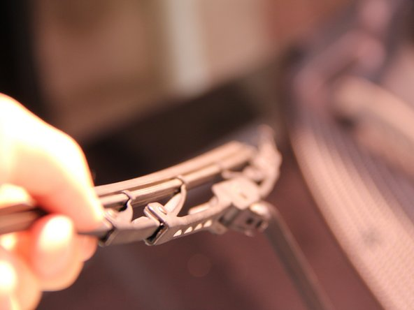 After removing the clasp, pull the blade from the wiper arm.
