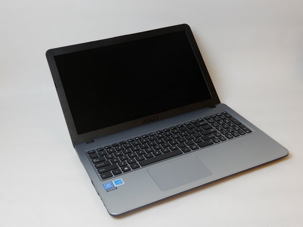 Flip the laptop back over and open it, revealing the screen and keyboard.