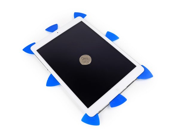 Pop pop! Oh the glorious sound of an iPad popping open, with a mysterious coin for mysterious scale.