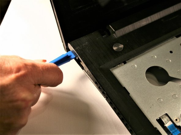 Once screws are removed,  begin by gently prying up in one corner using a spudge