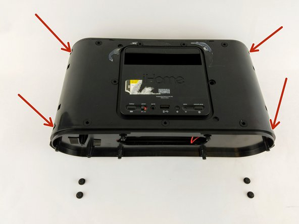 Use a plastic spudger to remove the rubber grommets from the four corners of the speaker underneath the mesh frame.