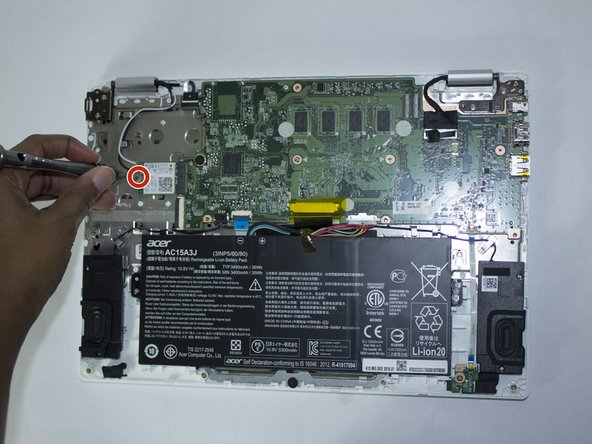 Remove the single 2.85 mm Phillips #1 screw that secures the wireless card.
