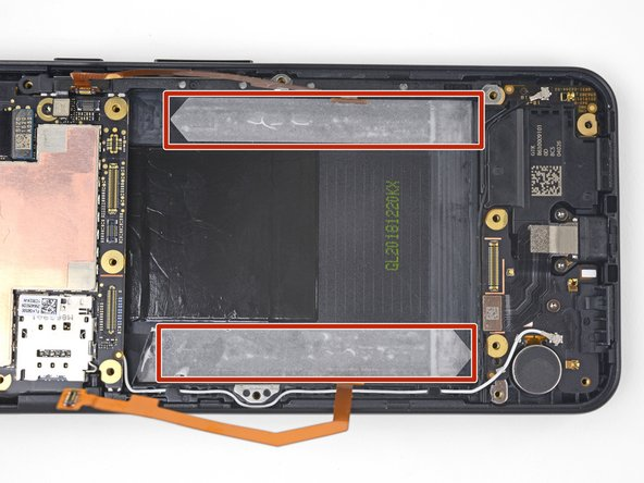 The battery is held in place by two stretch-release adhesive strips.