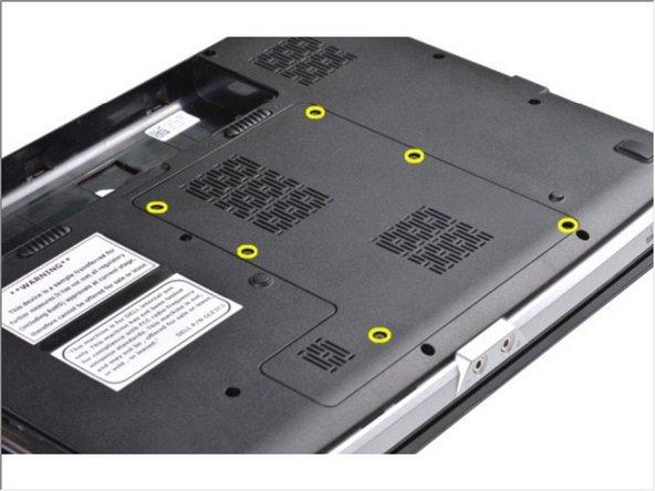 Retire los seis tornillos que aseguran el panel de acceso a la computadora.