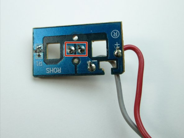 Use a soldering iron to heat up the two connections holding the LED to the circuit board. Remove the LED.