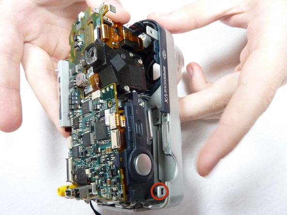 Simultaneously unclip all of the clips holding in the circuitry. Remove the back case.