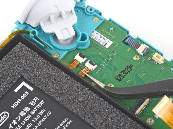 Use a pair of tweezers to slide the daughterboard screen cable out of its connector on the motherboard.