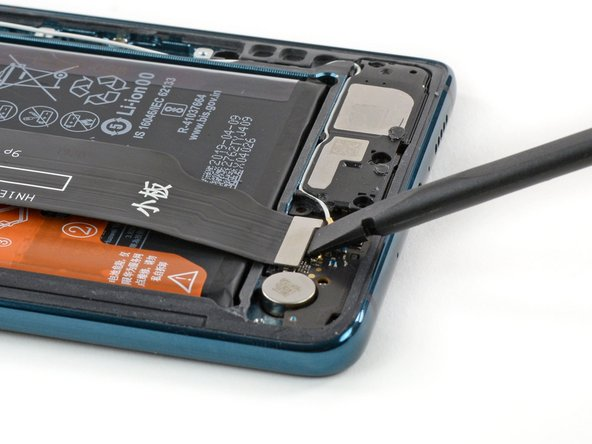 To get unobstructed access to the battery, we remove the board interconnect cable.