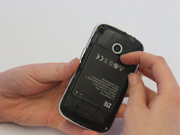 Pry the battery from the phone using your fingers.