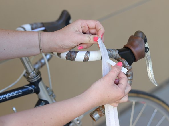 Peel off the adhesive covering from the back of the bar tape.