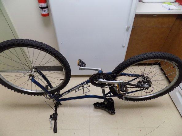 Flip your bike to make the brake housing more visible.