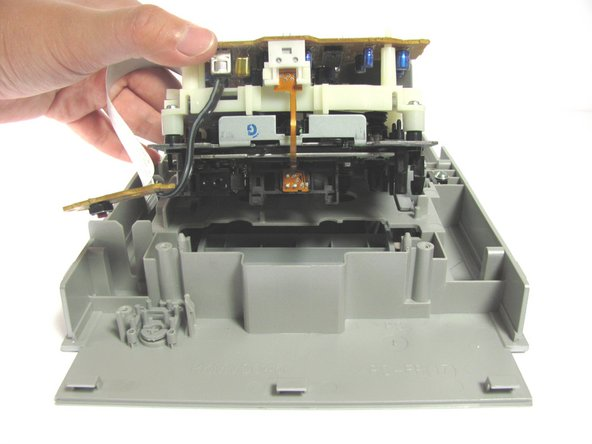 Carefully lift the cassette player out of the plastic casing.