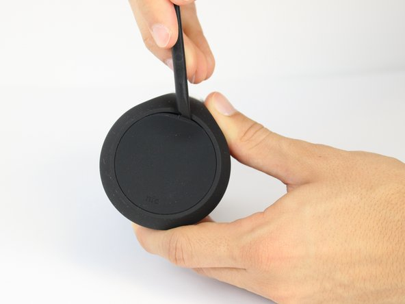 Begin by removing the rubber caps on both sides of the JBL Flip 2 by using the black spudger to get in between the creases.