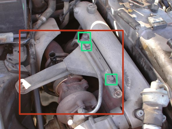 Underneath the air cleaner housing you'll find the bracket. It bolts to the exhaust manifold.