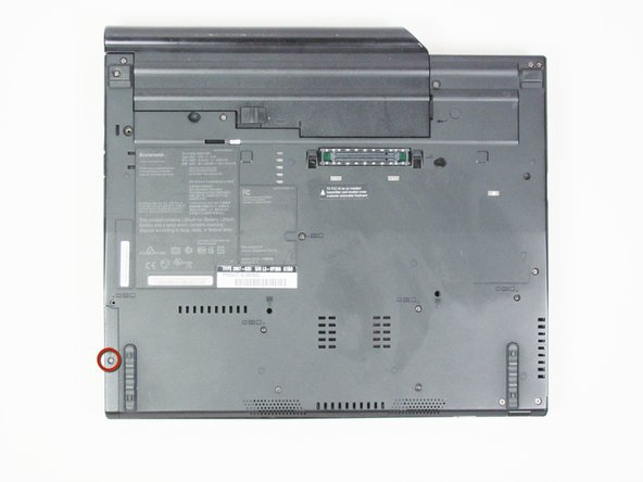 Turn the Thinkpad over so you can see the back.