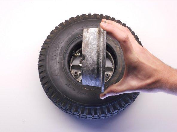 Locate the valve stem cutout on the top rim half.