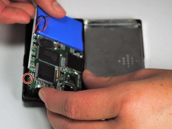 Carefully bend the plastic frame to remove the motherboard.