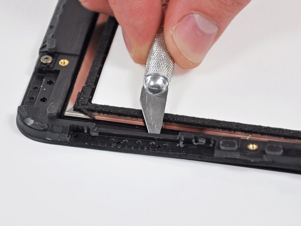 Lightly heat the rubber connection area. Use a plastic opening tool to separate the plastic display frame from the front glass panel enough to access the rubber area.