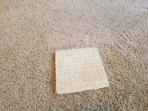 Flip sample carpet onto its back and place down on a stable surface.