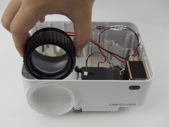 Remove the focus-adjustment ring from the lens housing.