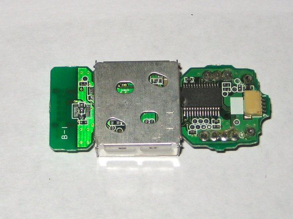 The PCB has a metal RF shield that protects the radio from interference from the game console; this extends the useful range of the controller.
