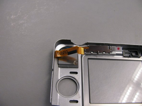 Reattach the back casing as well as the small ribbon with it to the camera body.