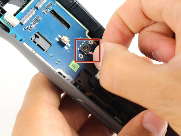 Disconnect the three-pin cable gently by pinching the cable with two fingers and pulling up.