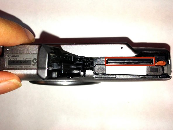 To open the battery compartment where the memory card is stored, refer to the Battery Replacement Guide.