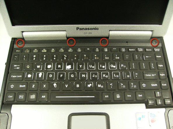 Remove the four screws above the keyboard using a Phillips #0 screwdriver.
