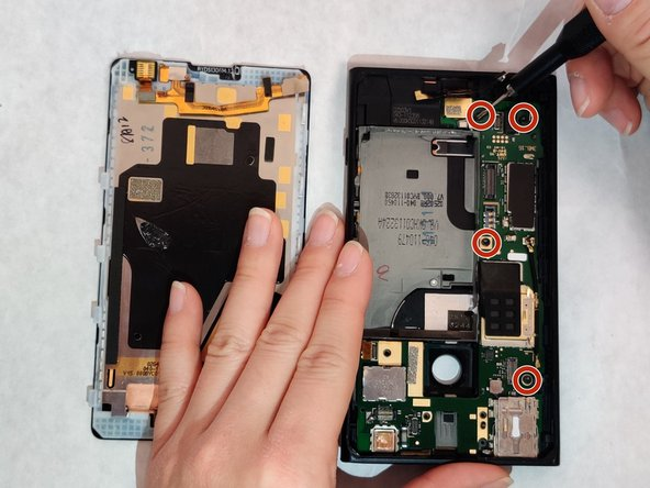 Using a T4 screwdriver, remove four 4.60 mm screws to disconnect the motherboard from the rest of the device.