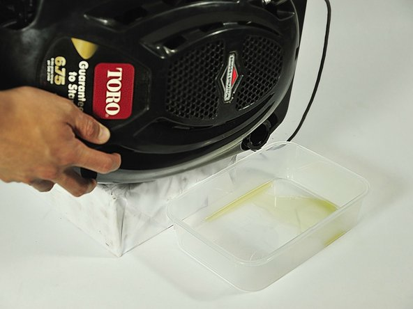 Check to make sure there is no fuel in the tank before removing the oil.