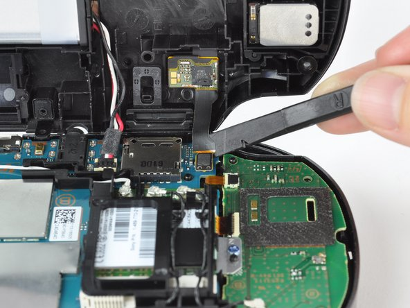 Using a spudger, free the touch screen controller flex cable by gently prying up the connection.