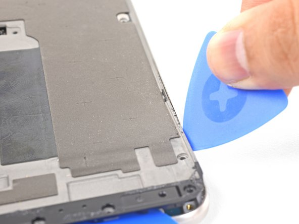 Insert a separate opening pick into the right edge of the phone, near the bottom.