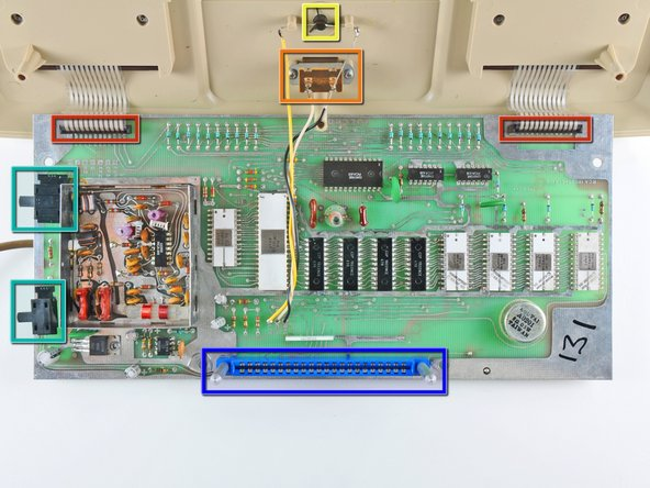 After the bottom cover is removed, the board can be rotated out of the top case to reveal the ICs hidden on its top face.