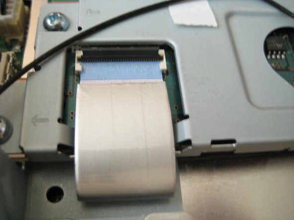 Remove the flat ribbon cable from the wireless assembly.