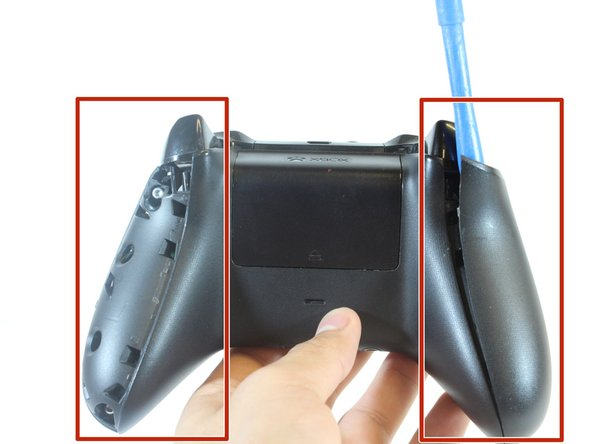 Remove the side handles with the iFixit plastic opening tool by wedging it around the seam of the handles.