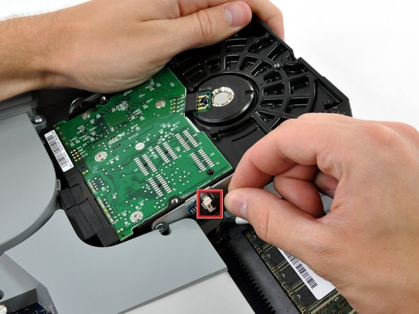 The following action is optional. If you skip this step, be very careful not to strain the thermal sensor cable as you disconnect the hard drive cables and transfer this bracket to your new hard drive.