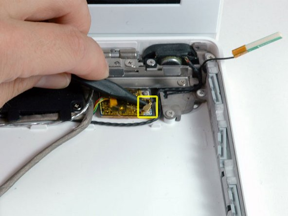 Use a spudger to disconnect the gold Bluetooth antenna connector from the Bluetooth board.
