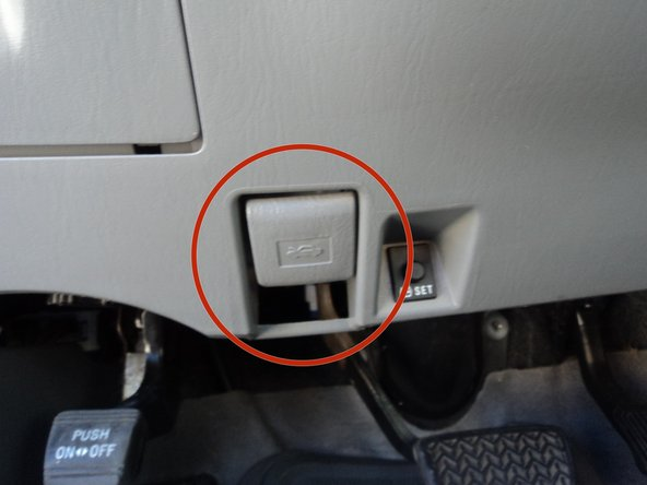Pull the hood release latch. The latch is  located  inside of the car under the steering wheel.