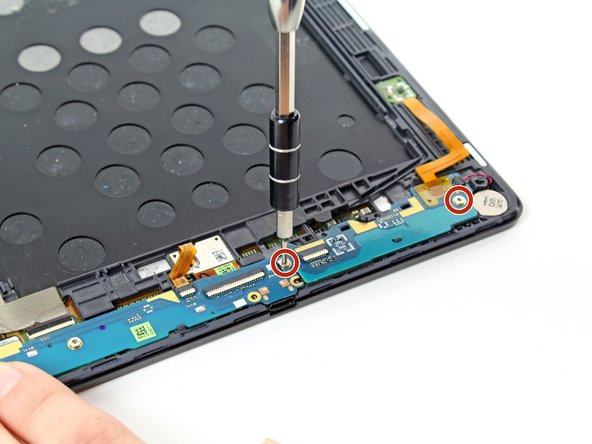 Unscrew the two 3mm T5 Torx screws securing the daughterboard to the device.